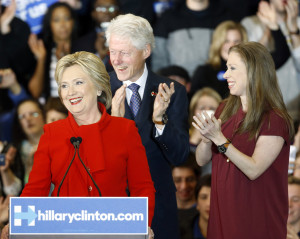 Democratic presidential candidate Hillary Clinton speaks in front of former President Bill Clinton and daughter Chelsea during a caucus night rally at Drake University in Des Moines, Iowa, Monday, Feb. 1, 2016. (AP Photo/Patrick Semansky)